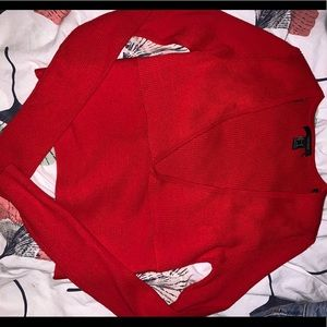Bright red long sleeved deep V women's top